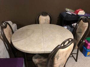 Table with 4 chairs and centre leaf