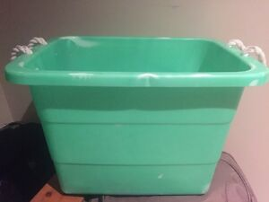 Green and a pink  toy bin