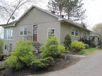 sweet 2 bedroom bungalow has 2 plus acres with waterfront !