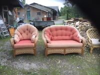 A cane settee and armchair.