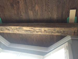 Finished Hand hewn barn beam fireplace mantle