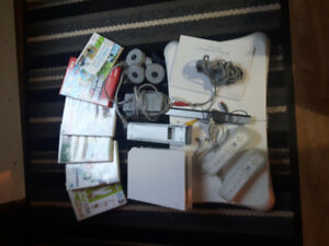 Wii Fit for sale with board, hand controls and several games