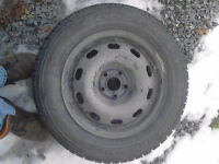"New Studded 15"" tires with rims"