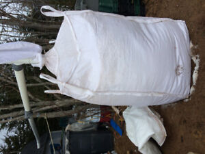 Large industrial bags of sawdust