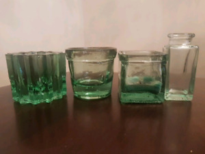 Assorted green glass votives