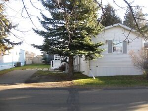 Spacious upgraded mobile w/ beautiful cabinets in Evergreen