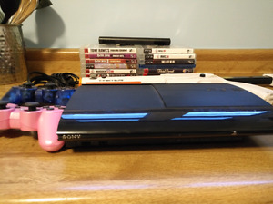 Ps3 with 14 gamea , 2 controllers, and cabelas gun plus game