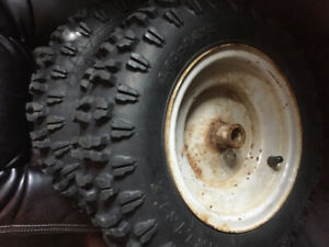 Snowblower tires and rims.