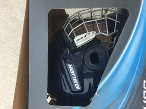 For sale brand new Bauer navy Smal hockey helmet