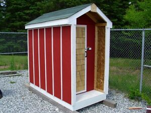 New children's playhouse and shed for sale.