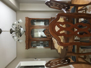 Dining room table, 4 chairs and cupboard