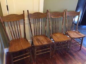 Antique Lion press back chairs