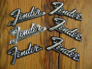 6 assorted older Fender metal badges