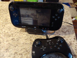 Wii U deluxe 32 GB set. Includes. Both controllers and two games