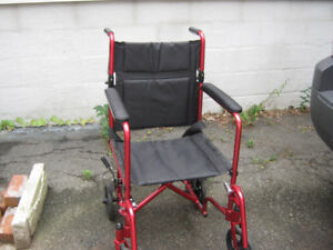 ultra light weight transport chair. slightly used mint condition