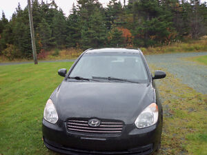 2010 Hyundai Accent black ,4 door, $3000.00
