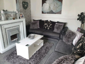 2 x 4 seater sofas and matching storage footstool
