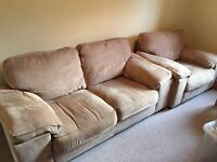 Beige fabric two seater, one seater and foot stool