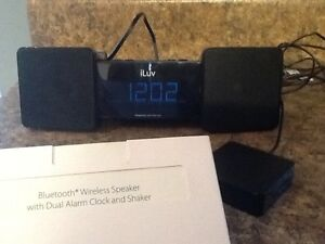 ILuv clock radio with built  in bluetooth speaker and shaker