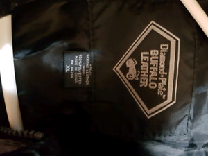 Leather bike jacket and chaps for sale