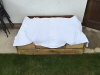 Large wood pallets made into dog bed/ rest area
