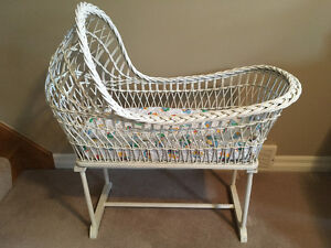 Antique white wicker bassinet