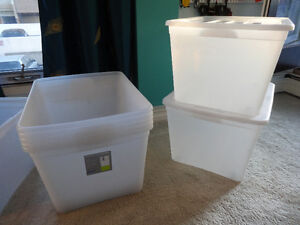 Clear storage bins with snap-in wheels