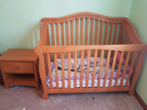 Wood crib with matching night table