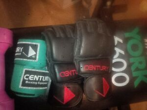 womans hand wraps and kickboxing gloves