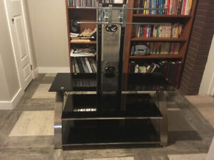 TV stand with smoked black glass shelves for accessories.