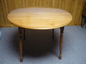 "Roxton Table 40""Round (52x40 )64""x 40""    (Optional 4 Chairs )"