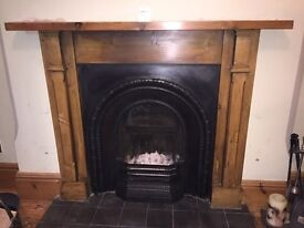 Cast iron fire and pine surround