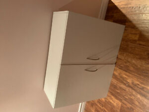 Small and medium size white cabinets