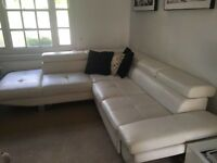 White faux-leather corner sofa-bed