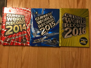 Three Guinness world record books in mint condition