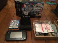Black Nintendo Wii U Premium Console. Boxed with Mario game