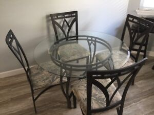 Glass patio table and four chairs