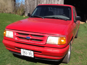 """1997 Ford Ranger XL, red,  sold """"as is"""" used as farm truck"""