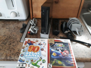 Nintendo Wii System With Wii Remote, Nunchuk And Super Mario!