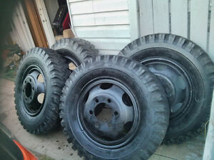 set of 4 tires and rims 8.25R20 for quick sell