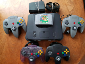 Nintendo 64 With 4 Controllers And Super Mario 64