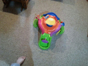 3 different fun baby toys, including a saucer