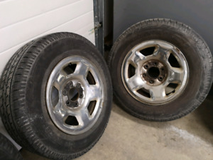 Two 245 70 R17 rims and tires