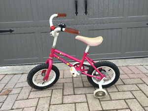 Girls Hot Pink Bike with Training Wheels and Bell from To Wheels