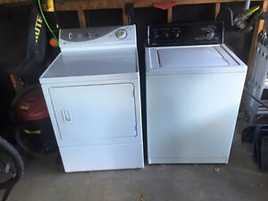 Top washer Kenmore front load dryer Maytag