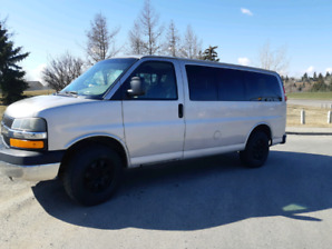 12 passenger Chev express 3500 with sliding door.