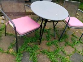 Metal garden table & 2 chairs plus cushions