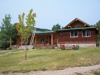 Beautiful Fraser Lake Acreage with Log home and outbuildings