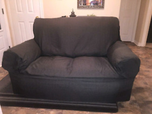 Loveseat with slipcover 38dx60wx38h must sell