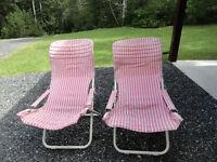 Slung back folding canvas chairs